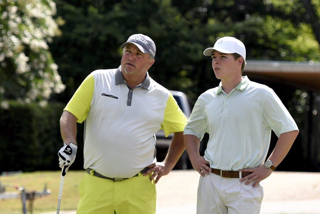 Lewis Lecroy (L) talks with interested spectator Logan Archer while waiting to hit Sunday. Archer, a former Oxford golfer, is transferring to North Georgia College from West Alabama in the fall. (Photo by Sandra Howell)