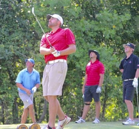 The four players on the tee box -- (from left) Chase Thomas, Kevin Garnett, Casey Harmon and Ryan Huff -- finished in the top seven in the second flight. Thomas and Huff won the flight. (Photo by B.J. Franklin, GungHo Photos)