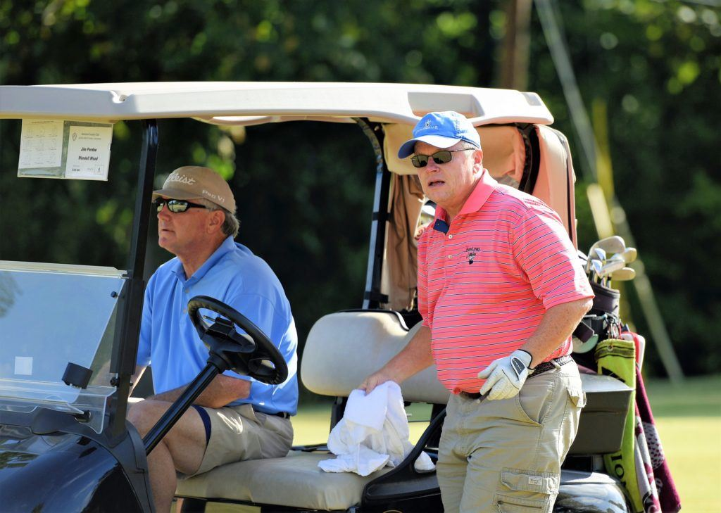 Jim Perdue (standing) and Wendell Wood shot 69 at Anniston CC Saturday. (Photo by Sandra Howell)