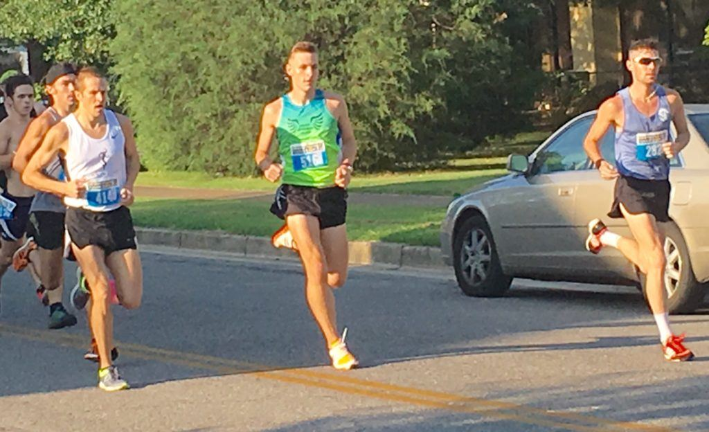 Race winner Jeff Rhodes (L), Donny Barnes of Huntsville and Samuel Mueller of Birmingham lead the Woodstock 5K runners as they come up Christine Avenue. All three finished in the top five.