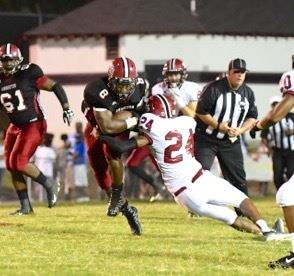 Anniston's Jeremy McCants (8) runs through Sylacauga defensive back Tommy Gaddis.