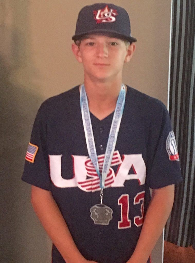 Oxford's Dawson Campbell wears his Team USA jersey and the silver medal he helped it win in the 12U Pan American Championships in Mexico. (Photos courtesy of Keith Campbell)