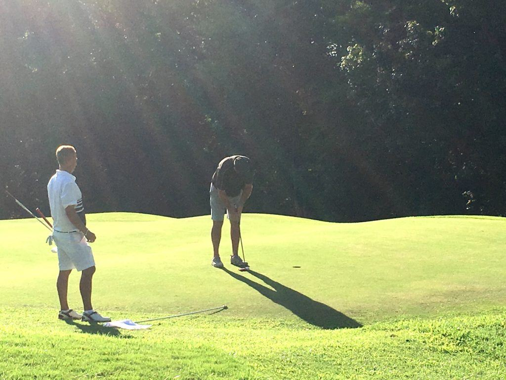 Ott Chandler stands over his tournament-winning putt on the second hole of sudden death Sunday.