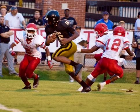 Oxford's Dave Russell (16) streaks through the Talladega defense with his 18-yard touchdown catch late in the first quarter Friday. (Photo by B.J. Franklin/GungHo Photos)