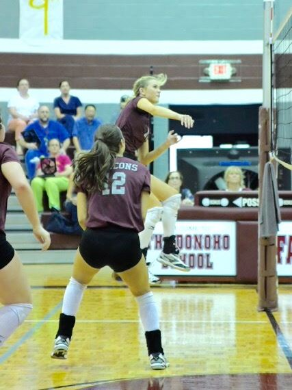 Donoho's Madison Gaines goes airborne to set a shot back over the net Thursday. On the cover, Janice Slay listens to pre-game instructions before the first game of her return as Donoho's volleyball coach. (Photos by B.J. Franklin/GungHo Photos)