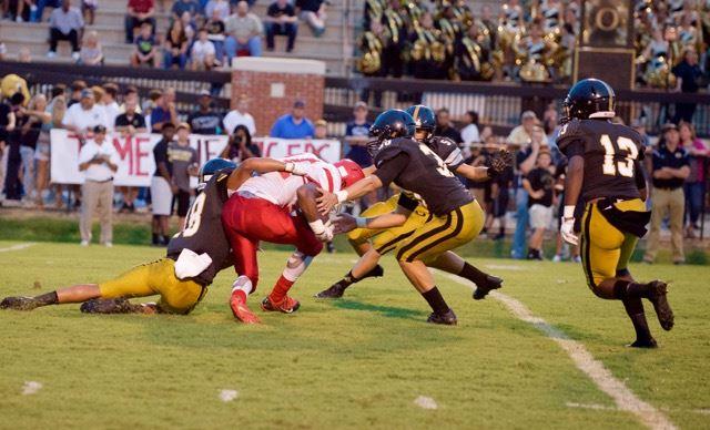 Cam Lemons (18) leads the way as Oxford's defense swamps Talladega quarterback Ashton Duncan. (Photo by B.J. Franklin/GungHo Photos)