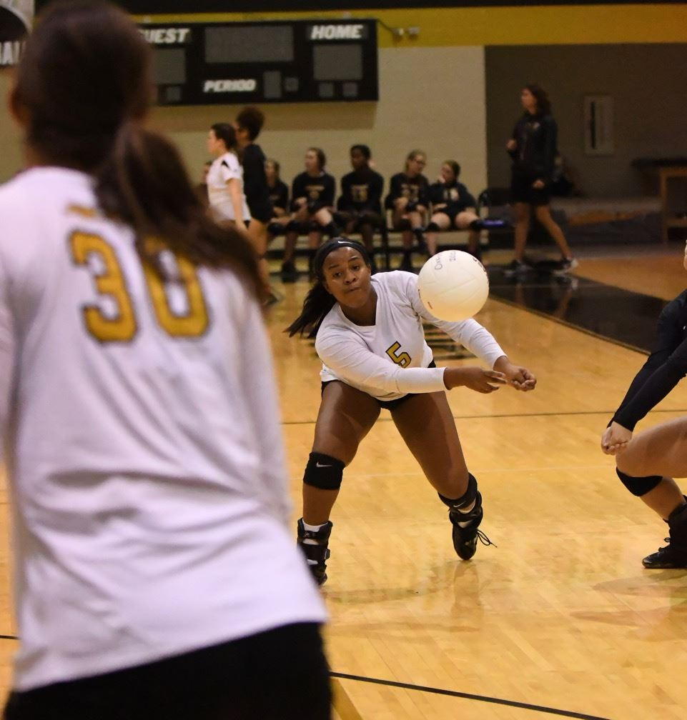 Makayla Kidd (5) makes one of several digs that kept points alive for Oxford.