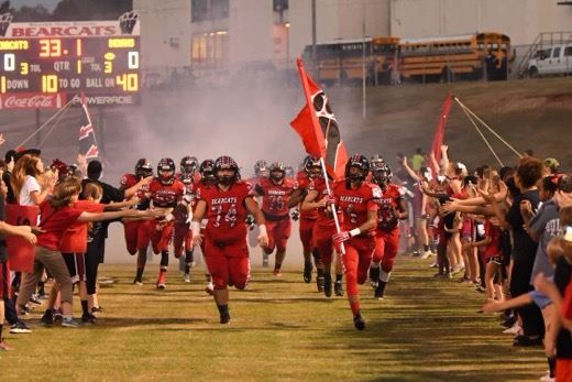 Here come the Weaver Bearcats through the spirit line. Below, the Ohatchee cheerleaders. (Photos by B.J. Franklin/GungHo Photos)