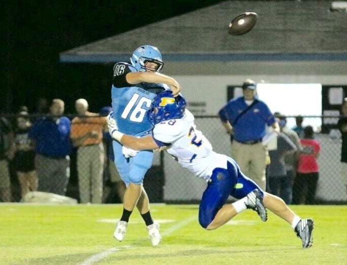Piedmont's Austin Brazier puts the pressure on Pleasant Valley quarterback Nick Howard. (Photo by Daniel Lee)