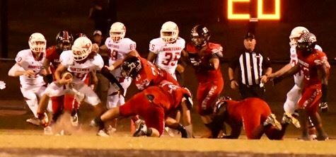 Ohatchee quarterback Taylor Eubanks (14) breaks away from the pack. Eubanks ran for two touchdowns in the game.