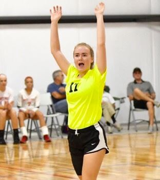 Faith Christian libero Abby Kazanjian raises her arms in triumph during the Lady Lions' tri-match with Southside and Ohatchee Thursday night. On the cover, Kazanjian returns a shot in front of teammate Sarah Kate McVeigh. (All photos by B.J. Franklin/GungHo Photos)