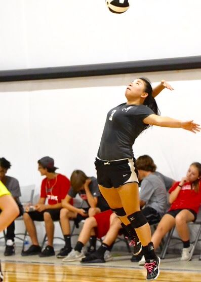 Faith's Emily Sills gets full extension on one of her effective serves. She had six aces in two matches.
