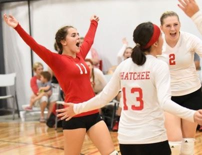 Ohatchee's Shelby Crump (11) celebrates a bit of good fortune with teammates Jazmine Adams (13) and Madison Howard (2) during their match Thursday night.