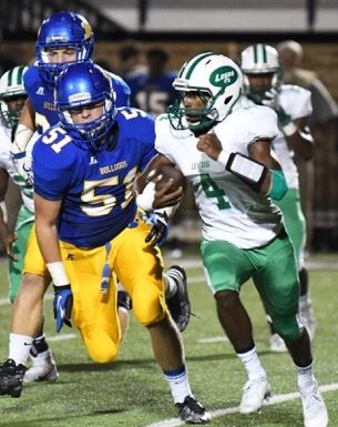 Piedmont Gavin Kircus (51) runs down Leeds quarterback Jaylen Washington. (Photo by B.J. Franklin/GungHo Photos)