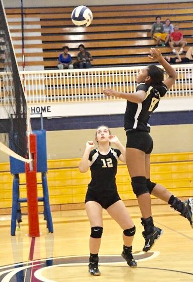 Oxford's Emma Connell (12) and Nyia Archie in action during a match earlier this season. (Photo by B.J. Franklin/GungHo Photos)