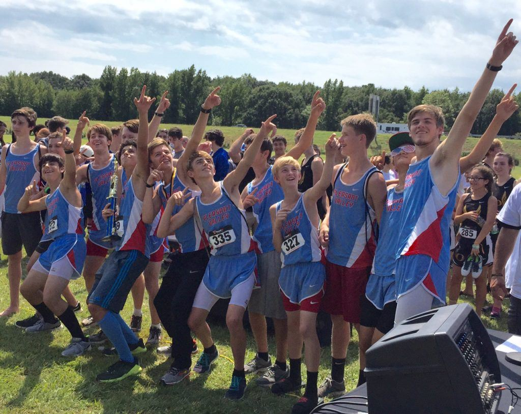 The Pleasant Valley boys cross country team breaks into their happy dance as they collect the winner's trophy Saturday.