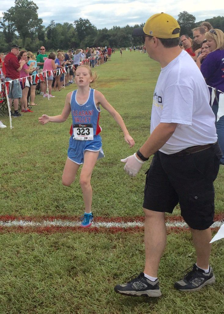 Pleasant Valley's Trinity Roberts comes across the finish line to win the girls race.