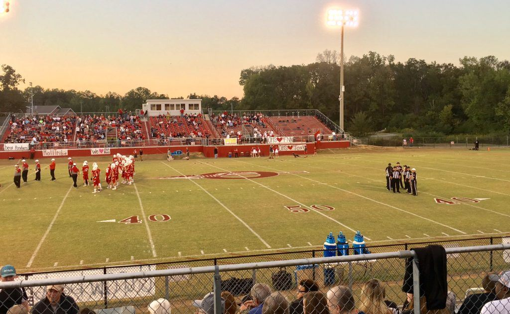 It's about 30 minutes before kickoff, Ohatchee goes through its pregame routine and the officials huddle in the vacant end of the field while everyone waits for Wellborn to arrive.