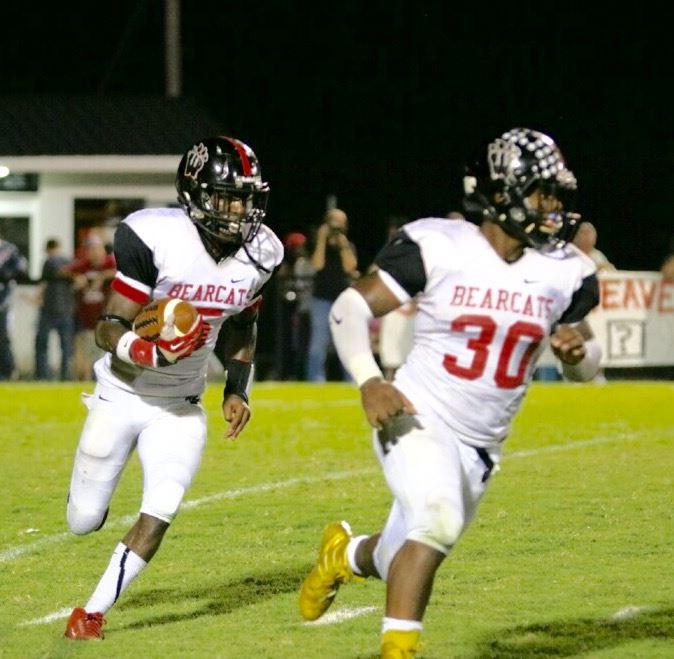 Weaver's Paul Hubbard (5) is following right behind the blocking of fullback Tyrik Hall. Check out the gold shoes.