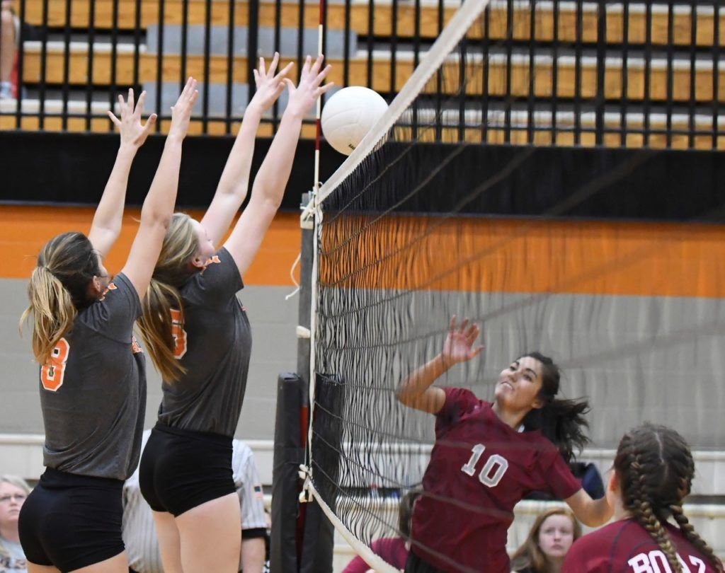 Alexandria's Taylor Spradley and Kendal Bumpus (8) block the ball back over the net in their area championship match against Boaz. (Photo by B.J. Franklin/GungHo Photos)