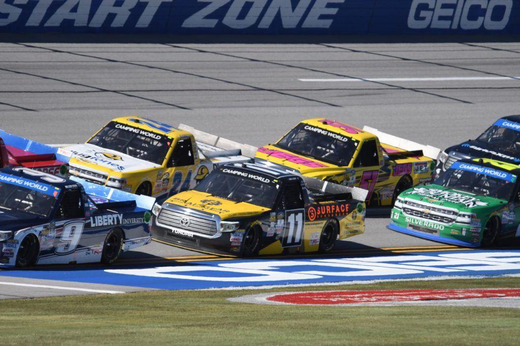 Race winner Grant Enfinger (24) drives in tight quarters.