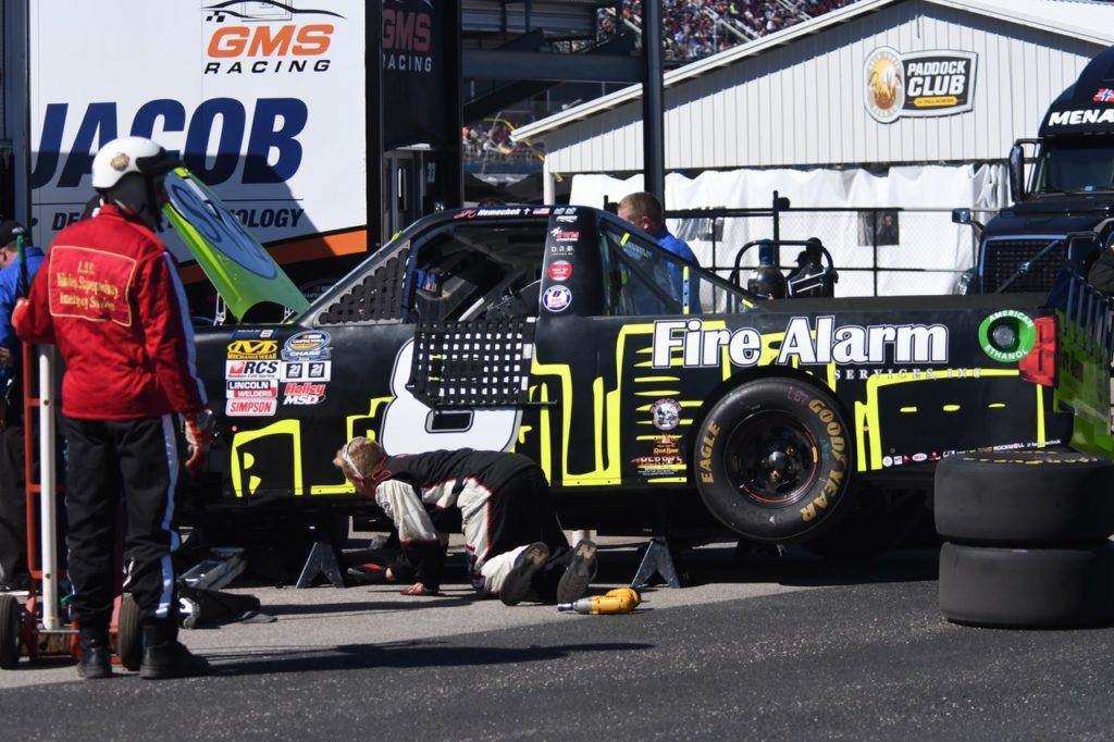 Team members work to figure out just went wrong to cause Chase contender John Hunter Nemechek's engine to go early in the race. (Photo by B.J. Franklin/GungHo Photos)