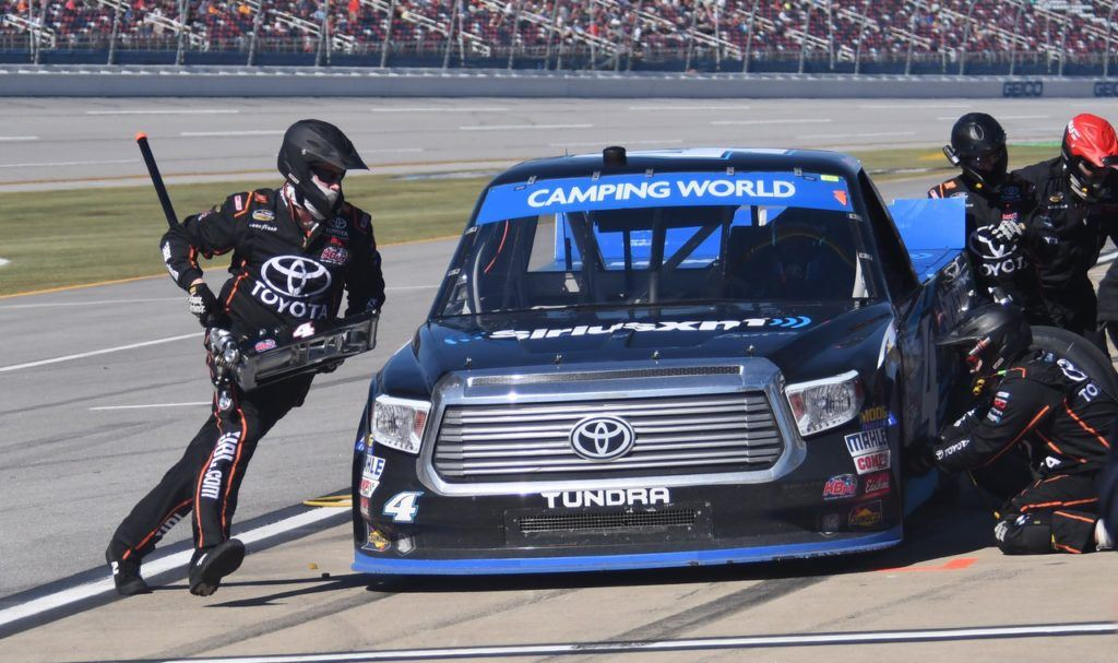 Crew members work quickly to get Christopher Bell out of the pits and back into the race. Bell advanced to the next round of the Truck Series Chase. (Photo by B.J. Franklin/GungHo Photos)