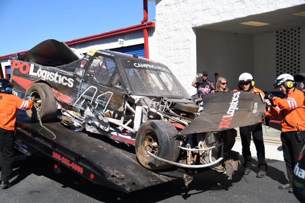 Track workers bring the remains of Ben Rhodes' truck off the wrecker after it got caught up in the biggest incident of the race. Rhodes was running in third  when he got bumped from behind and touched off a wreck that collected 14 trucks.