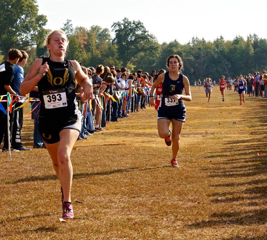 Oxford's Toni Coley (L) sprints to an eighth-place finish ahead of Jacksonville's Mary Shelton.