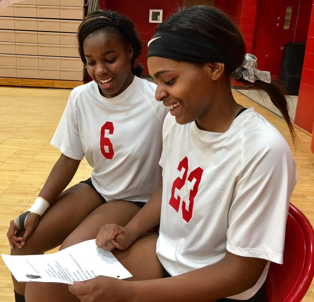 Weaver's Amira Carter (6) and Mariah Thompson look over the team's 2014 goals that are still relevant -- and achievable -- today.