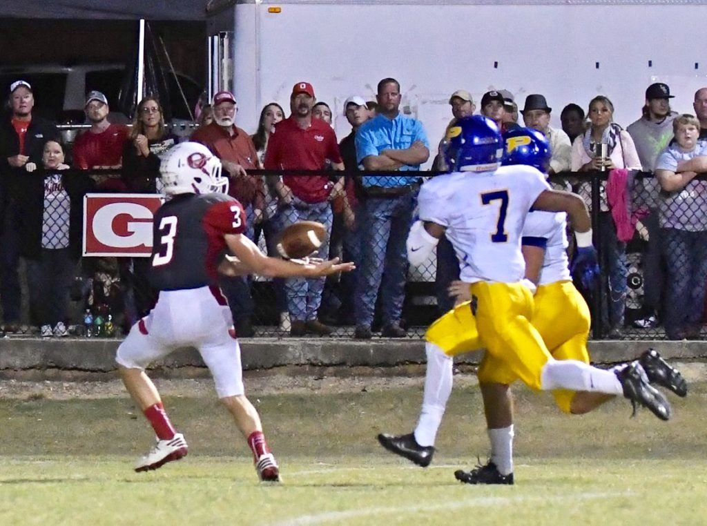 Austin Tucker (3) beats the Piedmont defense and watches the ball into his hands on the touchdown pass that started Ohatchee's second-half comeback.