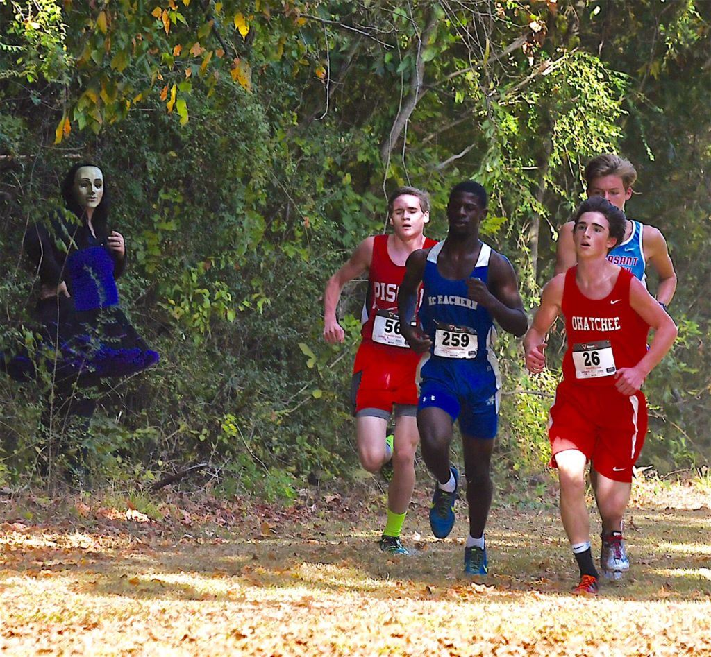 McEachern boys race winner Justin Seymour brings the lead pack past a ghoul in the woods during Ohatchee's Terrortorium 5K at Oxford Lake. Pleasant Valley's Matisse Miller is at the rear; he suffered a leg injury midway through the race. (Photo by B.J. Franklin/GungHo Photos)