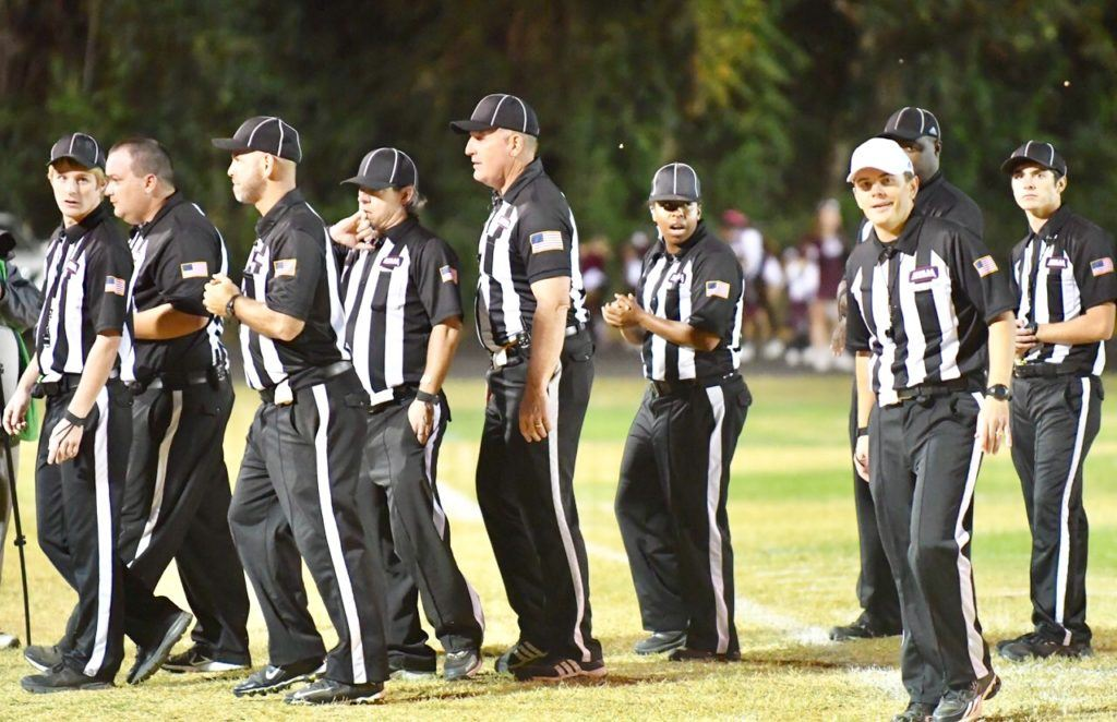 The officials get ready for the Wadley-Donoho game at Lentz Field. (Scoreboard, officials photos by B.J. Franklin/GungHo Photos)