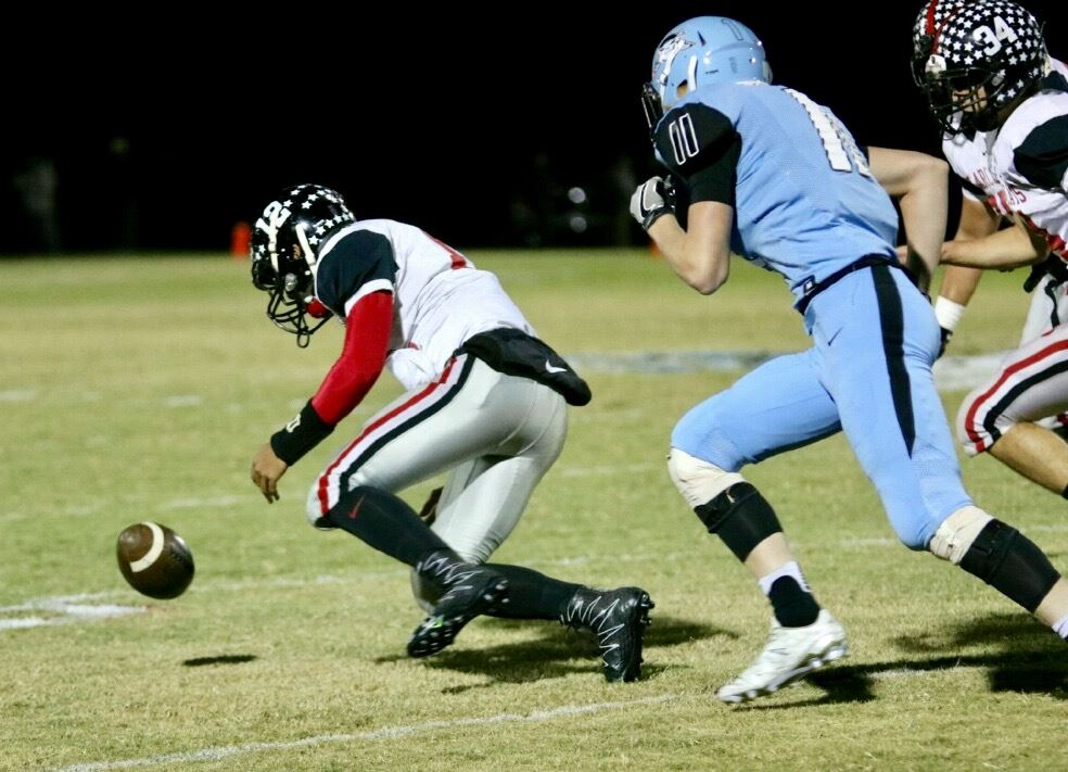 Weaver's Dalton Hamby gets behind Pleasant Valley's Dalton Payne to scoop up a fumble in the Bearcats' victory. (Photo by Daniel Lee)