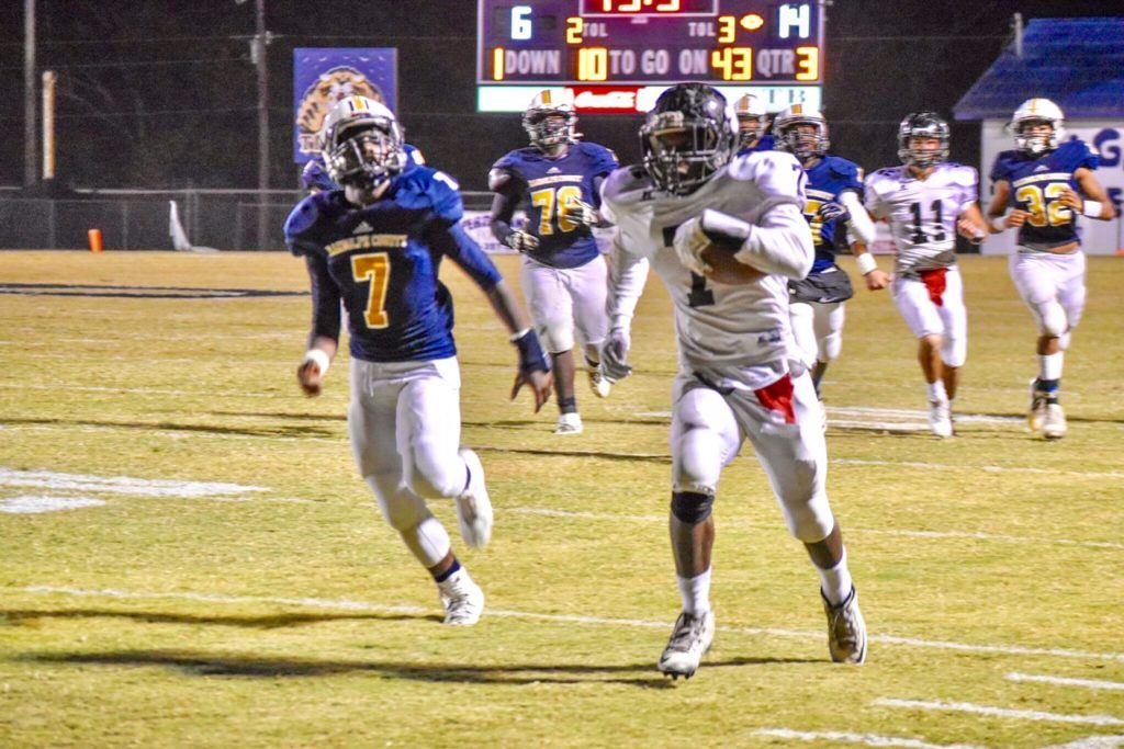 Wellborn's Javian Thomas (R) runs past Randolph County's Damarcus Davis for a touchdown that gave the Panthers a 20-6 lead. On the cover, Randolph County's Seth Hannah scores the first of two fourth-quarter touchdowns that helped bring the Tigers back. (Photos by Jeremy Wortham/Tiger Den Photography)