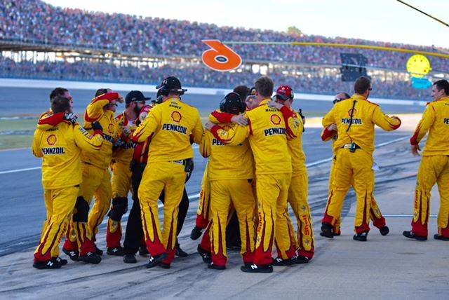 Joey Logano's pit crew celebrates after their man took the checkered flag.