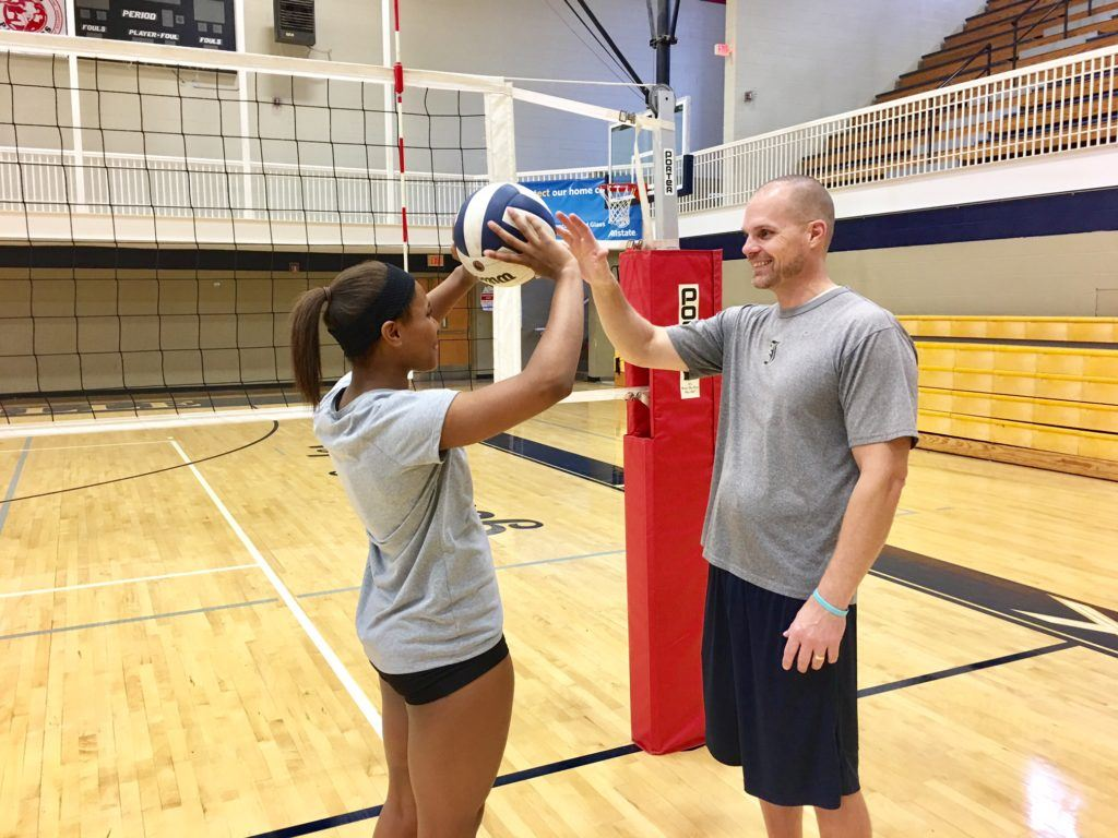Jacksonville coach David Clark (R) and senior Tatiyana Thomas discuss the finer points of setter play after a recent practice.