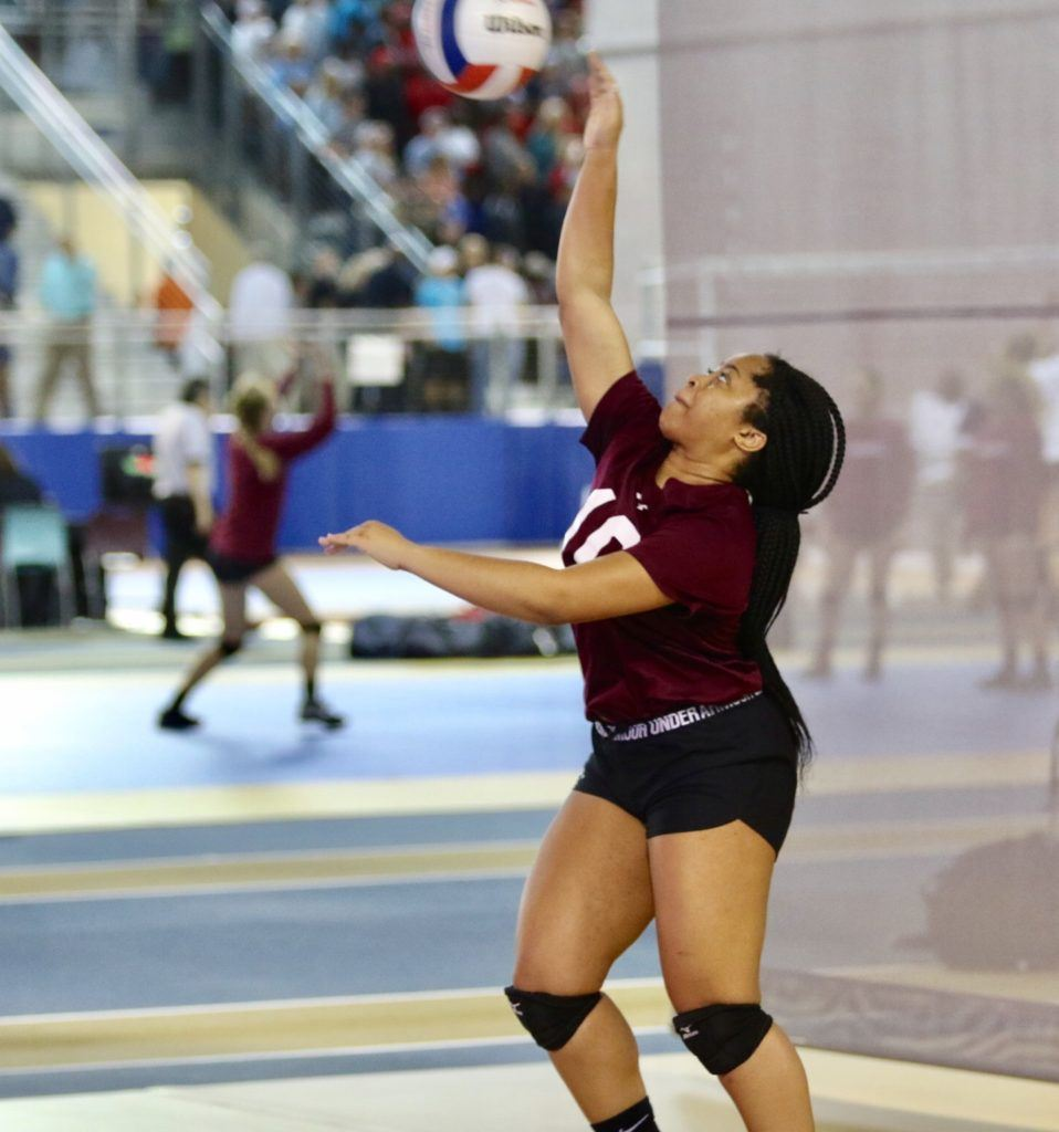 Sacred Heart's Jayla Woods serves to Isabella. Woods had 28 assists and two aces in the match.
