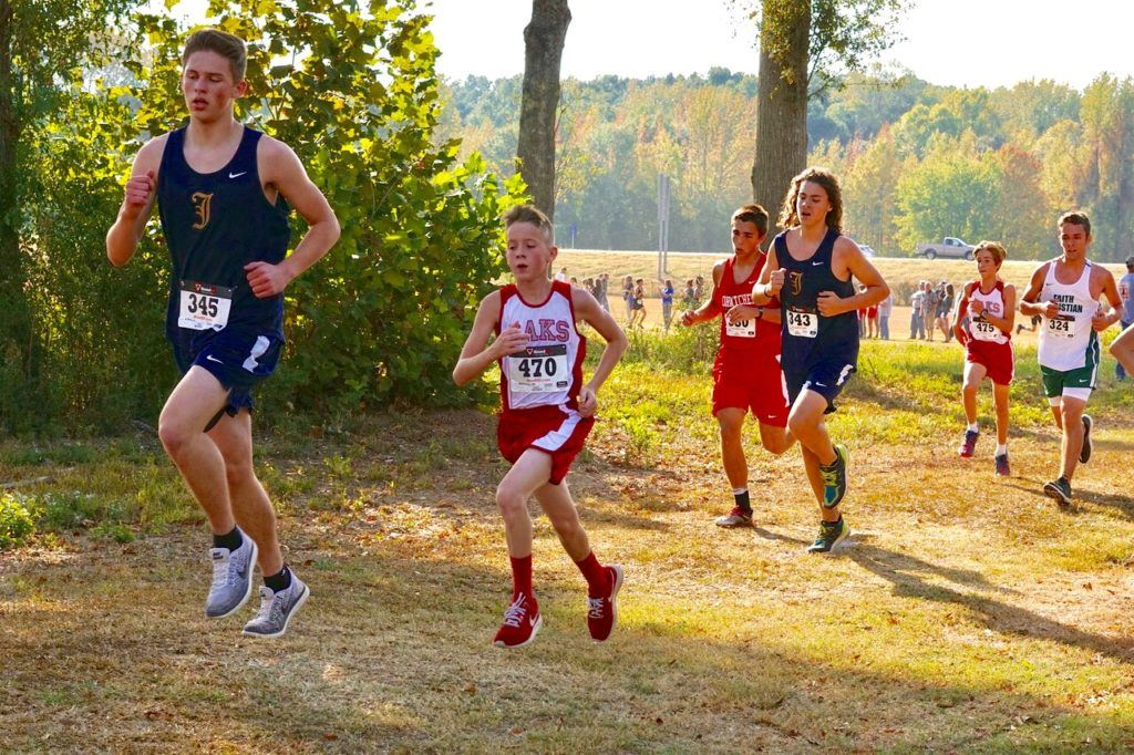 A pack of runners push through the tree line at Oxford Lake Park. The pack includes (from left) Alec Gilbert, Matthew Kennewy, Ben Glass, Joseph Francis, Stephan Ray and Zachary Patterson.