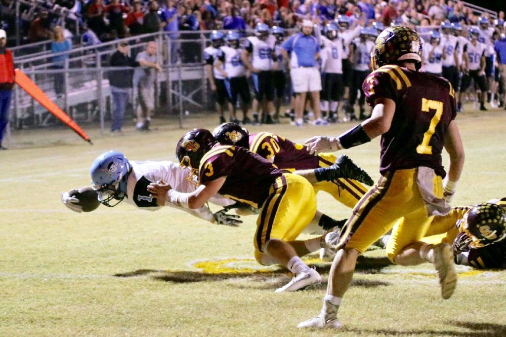 Dakota Jones lunges over the goal line for a Pleasant Valley touchdown.