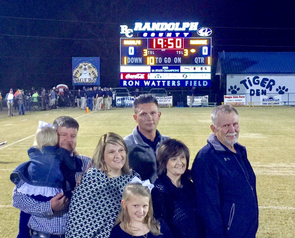 Former Randolph County coach Ron Watters and his family were recognized Friday with the coach having the football field named in his honor.