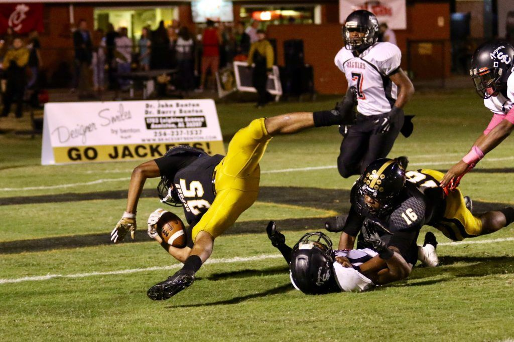 Oxford's Richard Cantrell (35) fights to keep his balance as nears the end zone for his third-quarter touchdown.