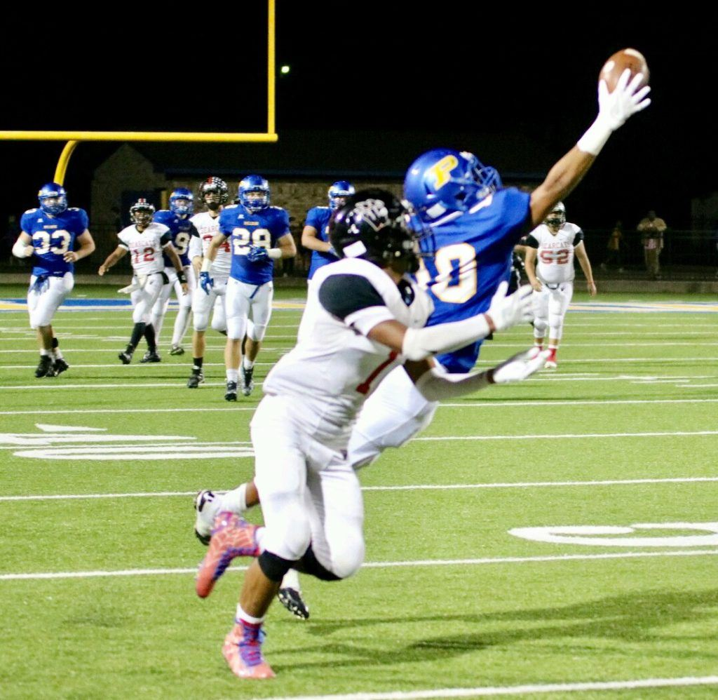 Piedmont's Cardavion Myers (10) stretches to make a one-handed grab in front of Weaver's Maurice Goodman. (Photo by Daniel Lee)