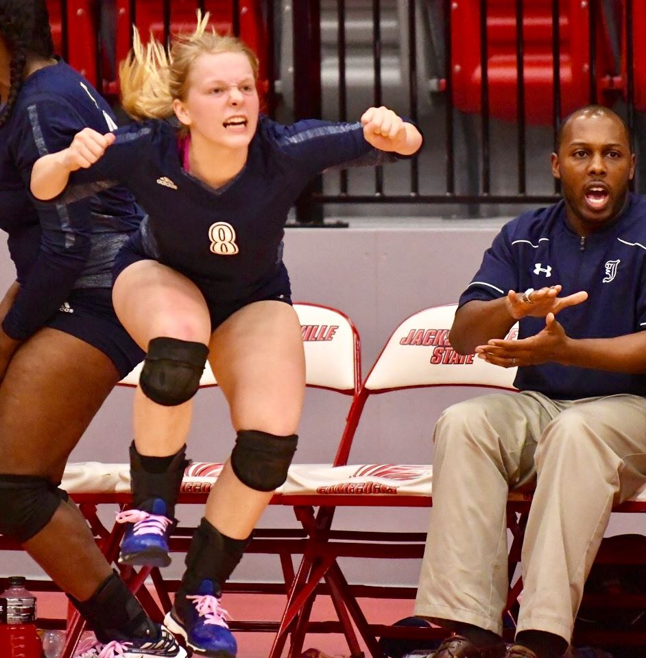 Jacksonville's Caitlyn Ryan (8) gets excited as the Lady Eagles get closer to winning the county volleyball tournament.