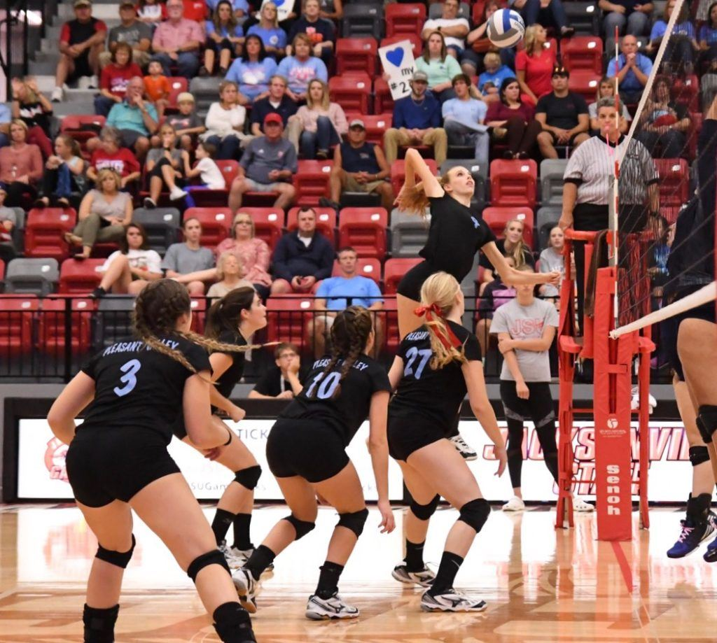 Pleasant Valley's Cammy Cochran, the tournament's outstanding offensive player, gets way up to hit one of her 20 kills in the championship match.