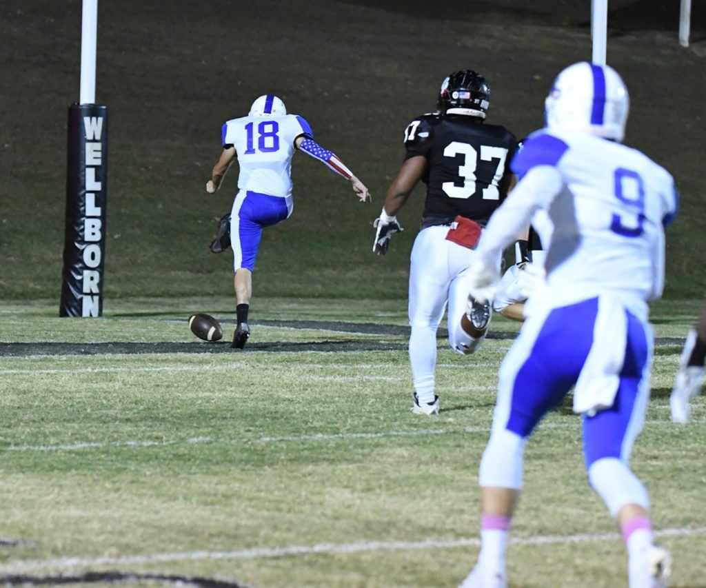 Joseph Harris (37) chases White Plains' Dakota Abramski and the football before recovering the ball in the end zone for another Wellborn defensive touchdown.