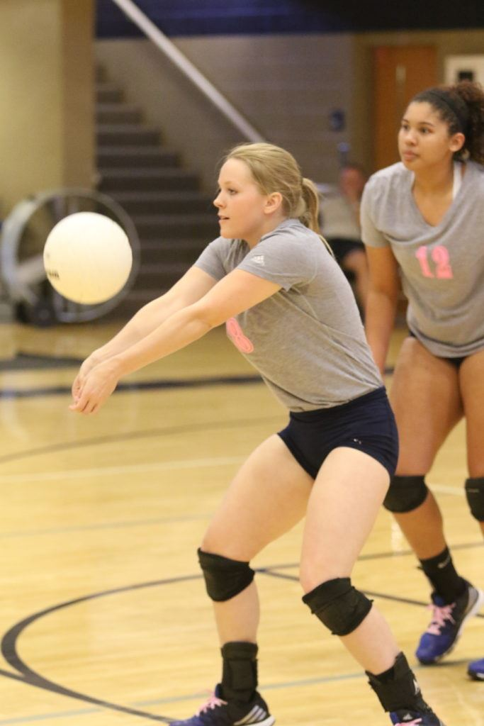 Jacksonville's Caitlyn Ryan keeps the ball alive in the Lady Golden Eagles' match with White Plains Tuesday night. (Photo by Kristen Stringer/Krisp Pics Photography)