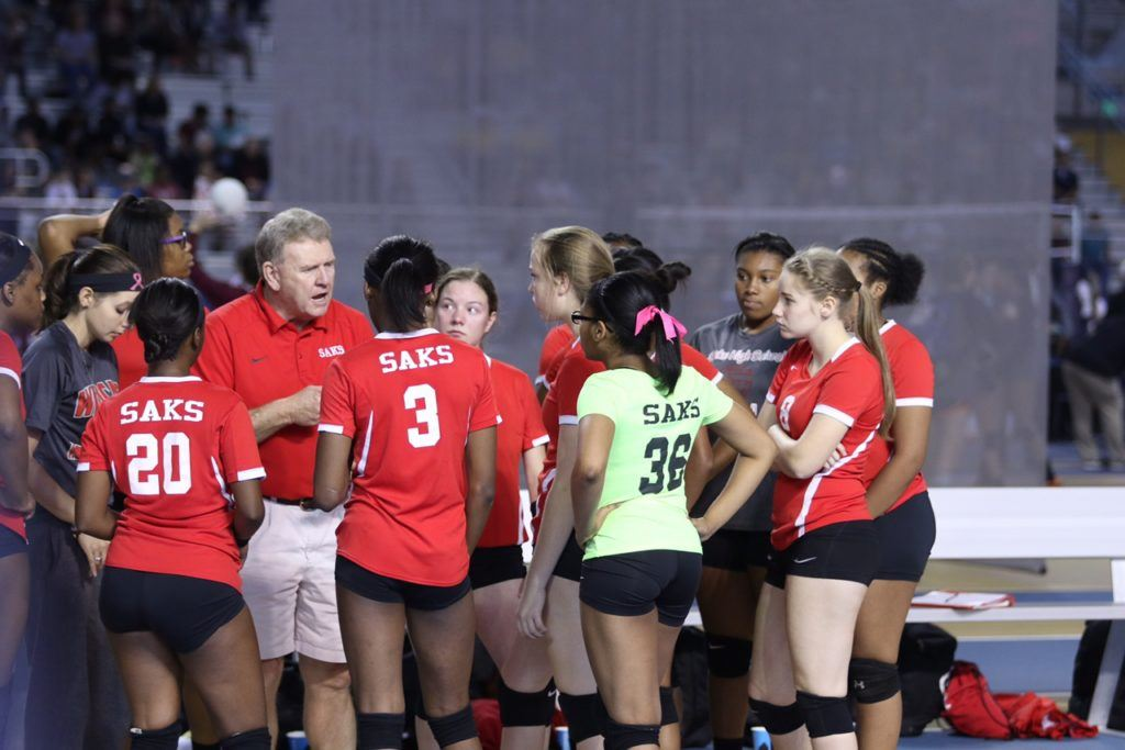 Saks coach Randy Law makes a point to his team during a timeout in its match with Jacksonville.