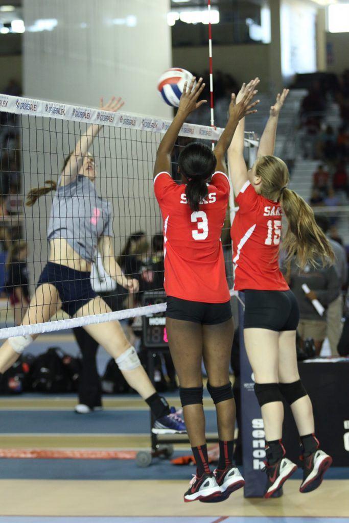 Saks' LaMonica Noel (3) and Madison Tate go up together to block Jacksonville's Elizabeth Poe.