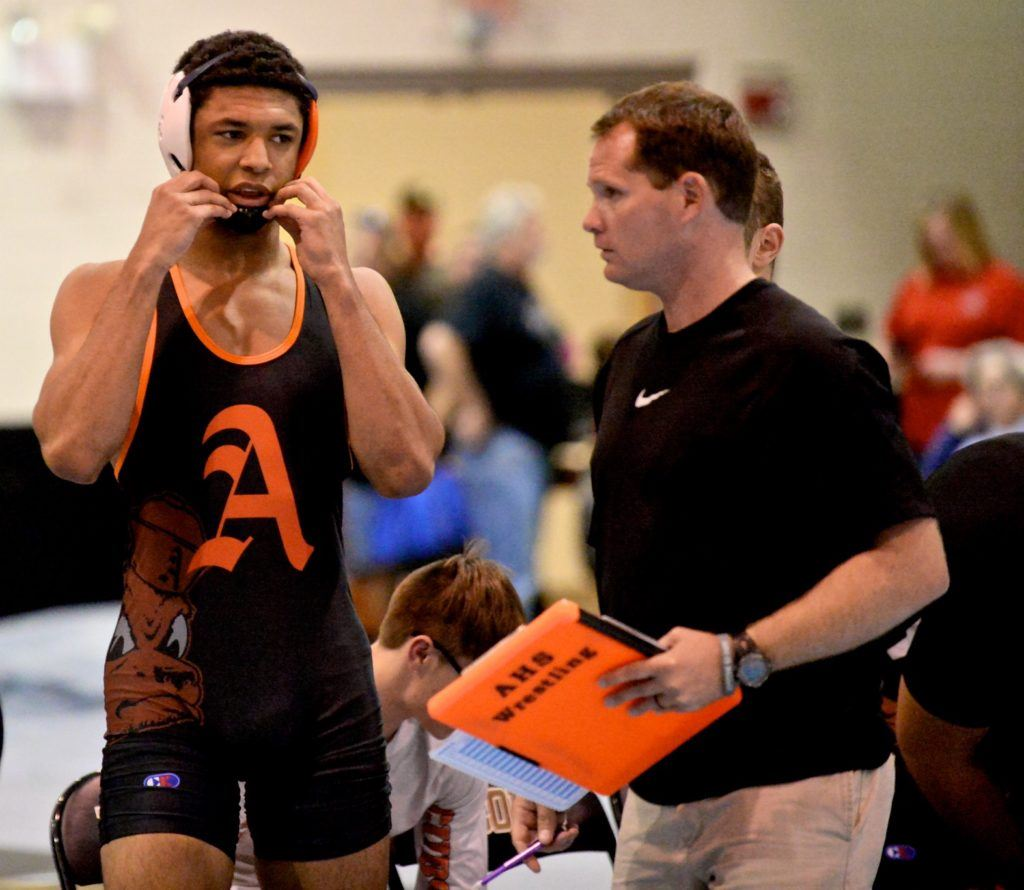 Christian Knop (L) gets some last-minute instructions from Alexandria coach Frank Hartzog before taking the mat for his first high school match of the season. (All photos by B.J. Franklin/GungHo Photos)